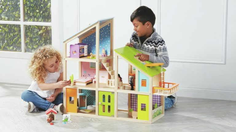 children building wooden toy house