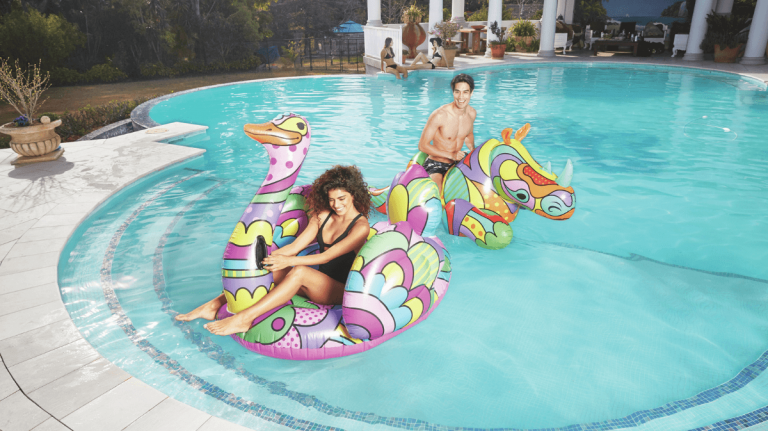 enjoying summer in swimming pool with floatie