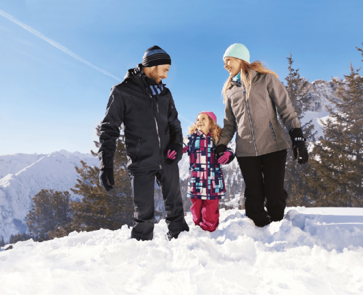 a family enjoying in snow with ALDI's Snow Gear